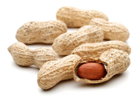Peanuts isolated on white background, macro shot Stock Photo
