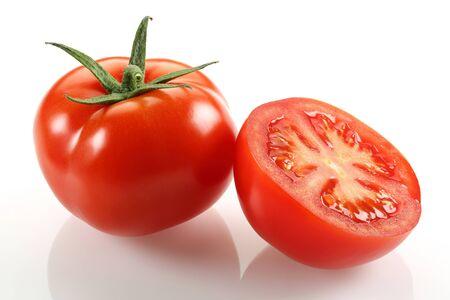 Half and whole fresh tomatoes isolated on white background Stock Photo