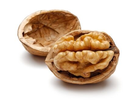 Cracked walnut isolated on white background