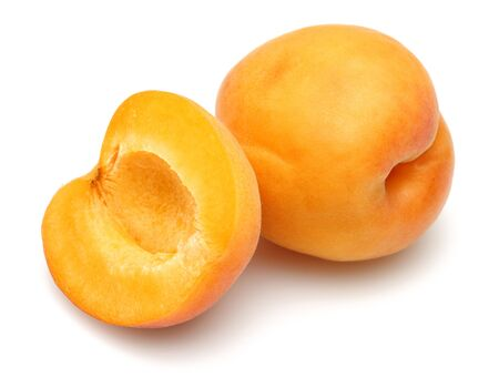 Fresh ripe apricots isolated on white background