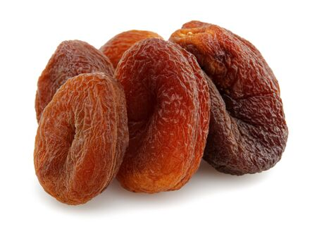 Organic dried apricots isolated on white background