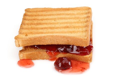 Toasted bread and strawberry jam isolated on white background Stock Photo