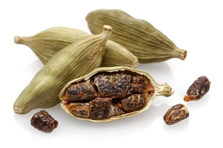 Cardamom pods and seeds isolated on white background