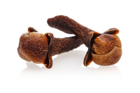 Dry clove buds isolated on white background Foto de archivo