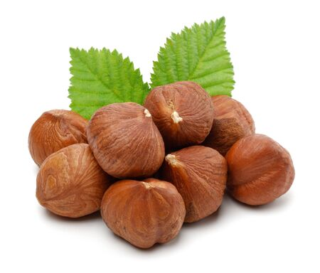 Hazelnuts and leaves isolated on white background