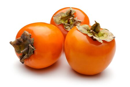 Whole ripe persimmon fruits isolated on white background
