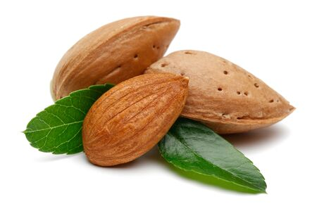 Group of almonds with leaves isolated on white background
