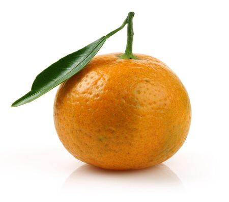 Single fresh tangerine with leaf isolated on white background