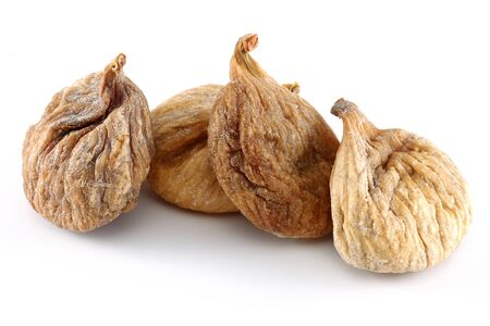 Heap of dried figs isolated on white background