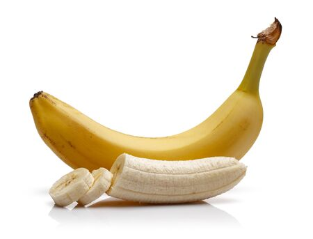 Ripe banana with slices isolated on white background