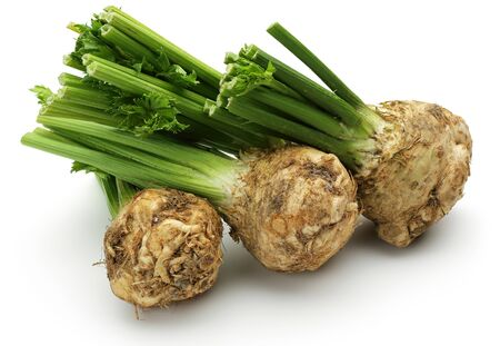Fresh celeriac root with celery stalks isolated background Stok Fotoğraf - 129944786