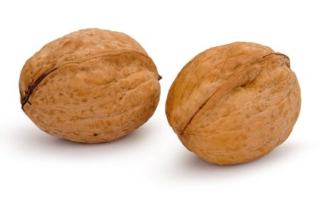 Whole two walnuts isolated on white background