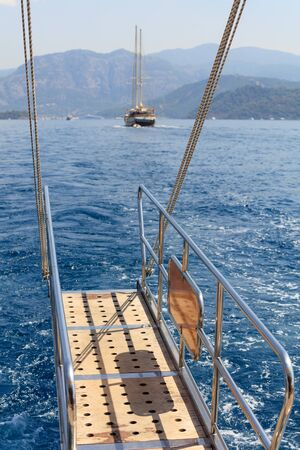 The stern of a yacht sailing in Mediterranean Sea Stok Fotoğraf
