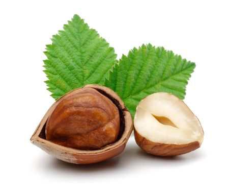 Group of hazelnuts with green leaves isolated on white background Archivio Fotografico