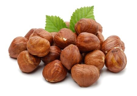 Group of hazelnuts with green leaves isolated on white background Stok Fotoğraf