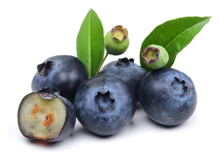 Fresh blueberries with leaves isolated on white background Stok Fotoğraf - 130426347