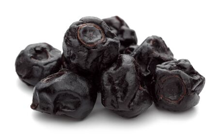 Heap of dried blueberries isolated on white background Imagens