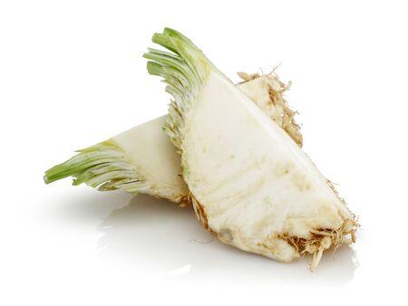 Fresh celeriac slices isolated on white background