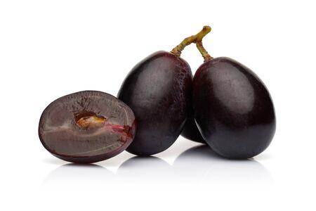 Fresh black grape isolated on white background Imagens