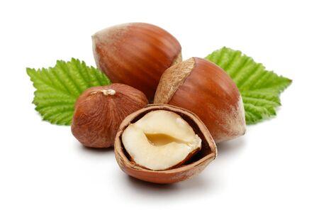 Hazelnuts with leaf isolated on white background