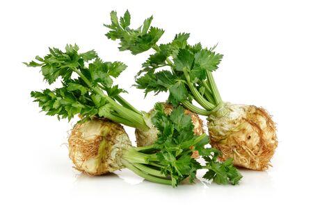 Fresh celeriac root with celery stalks isolated on white background Stock fotó