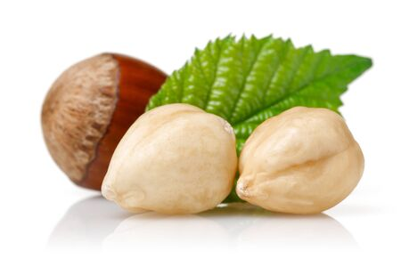 Group of hazelnuts with green leaf isolated on white background Stok Fotoğraf