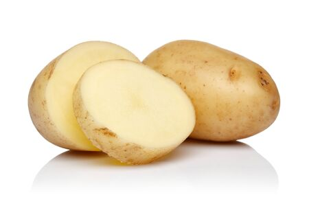 Fresh raw potatoes with slices isolated on white background