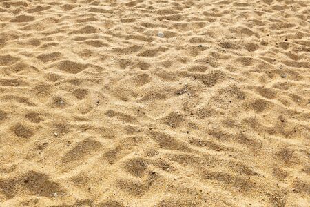 Background of yellow sands with footprints on it 版權商用圖片
