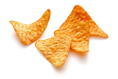 Triangle shaped corn chips isolated on white background