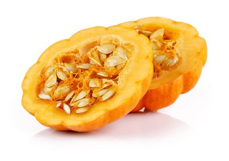 Half mini pumpkin with seeds isolated on white background