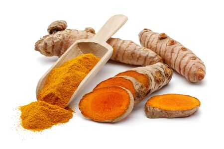 Fresh turmeric with slices and curcuma powder in a spoon isolated on white background 版權商用圖片