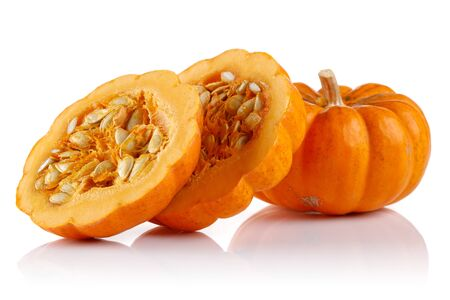 Whole mini pumpkin with slices isolated on white background