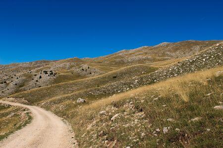 Mountain road on the mountain Bjelasnica, rocky landscape in autumn. Bjelasnica Mountain, Bosnia and Herzegovina.