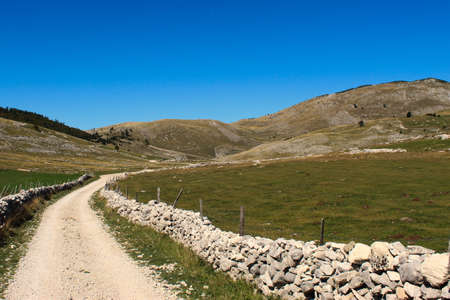 A mountain road surrounded by rocks. Bjelasnica Mountain, Bosnia and Herzegovina.