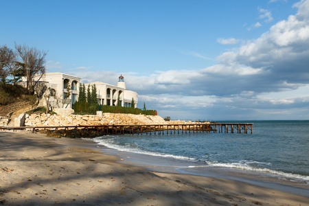 constantin: Small hotel on the beach of St. St. Constantin and Helena resort in Bulgaria with sea view against beautiful sky Editorial