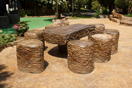 concrete surface finishing: Table and stools made of stamped pattern concrete in an open air area. Exterior design decoration ideas