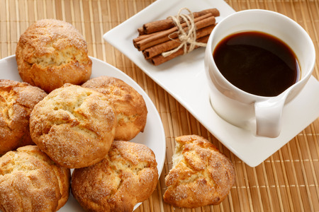 Traditional bulgarian cookies, called kurabiiki, cup of coffee and tied cinnamon sticks. Warm and delicious autumn breakfast Stock Photo