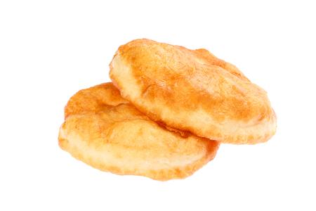 Traditional Bulgarian homemade donut like breakfast, named Mekitsa or Mekica, isolated on white background.