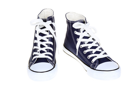 Pair of women`s high top lace up dark navy blue sneakers isolated on white background Banque d'images
