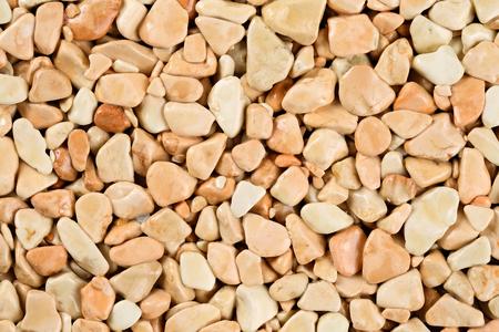 Alfombra de piedra natural extreme close up, de color beige y crema en diferentes tonalidades y tintes de beige. Revestimiento de piedra decorativa. Acabado de suelo antideslizante que contiene partículas de piedra natural.