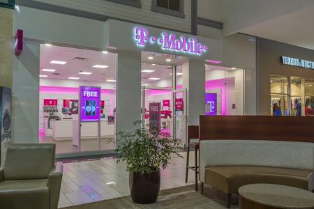 UTICA, NEW YORK, USA - JUNE 23, 2018: T-Mobile cellular operator shop in Sangertown Mall New Hartford, New York. Sajtókép