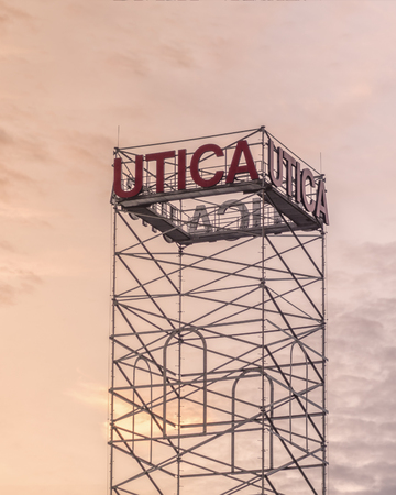 UTICA, NEW YORK - OCT 05, 2018: Utica City Tower Picture with Utica Sign in Red.
