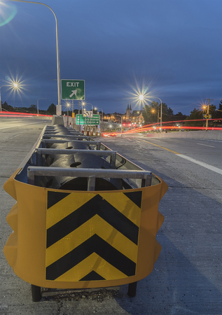 UTICA, NEW YORK - SEP 30, 2018: Night shot of Utica Interstate Highway with Cross Road Cushion Bum in the Foreground.