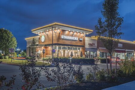 NEW HARTFORD, NEW YORK - AUG 16, 2019: Starbucks Coffee is an American chain of coffee shops, founded in Seattle. Imagens