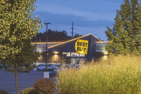 NEW HARTFORD, NEW YORK - AUG 16, 2019: Night view of Best Buy, is a major retail chain that sells all kinds of consumer electronics products.