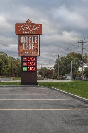 VERONA BEACH, NEW YORK - Oct 19, 2019: - Evening View of Maple Leaf Market Fuel Sign Prices, Maple Leaf is a Convenience Store Chain and Gas Station with All Day Food Serving Grab & Go.