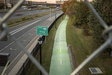 Albany, New York - Oct 15, 2019: Highway View and Bycle Trail of Interstate 787 thru Wired Fence