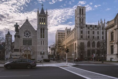 SYRACUSE, NEW YORK - JAN 14, 2020: Wide Street View of Columbus Circle in Foreground and Cathedral of Immaculate Conception and NYS Environmental Protection Fund in Syracuse, New York. Redakční