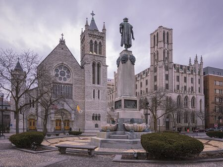SYRACUSE, NEW YORK - JAN 14, 2020: Wide View of Columbus Circle in Foreground and Cathedral of Immaculate Conception and NYS Environmental Protection Fund in Syracuse, New York.