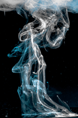 ink dropped in water , shot with nikond d5100 and a 35 mm lens - 3 light sources Stock Photo